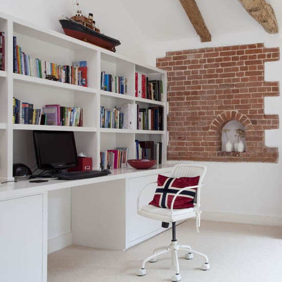 Desk built into a wall of shelves