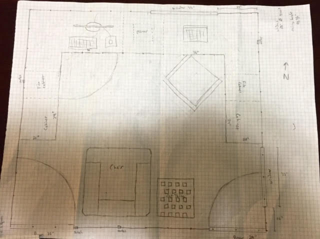 Pencil sketch of an office layout on graph paper